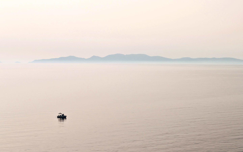 Boat sailing off the coast of Santorini