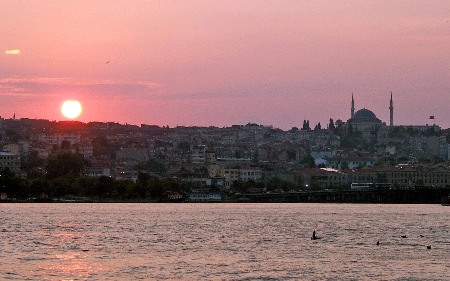 Pink sunset over Sultanahmet from the Galata Bridge