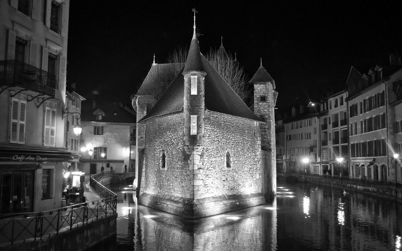 Annecy's Palais de l'Île prison by night, France