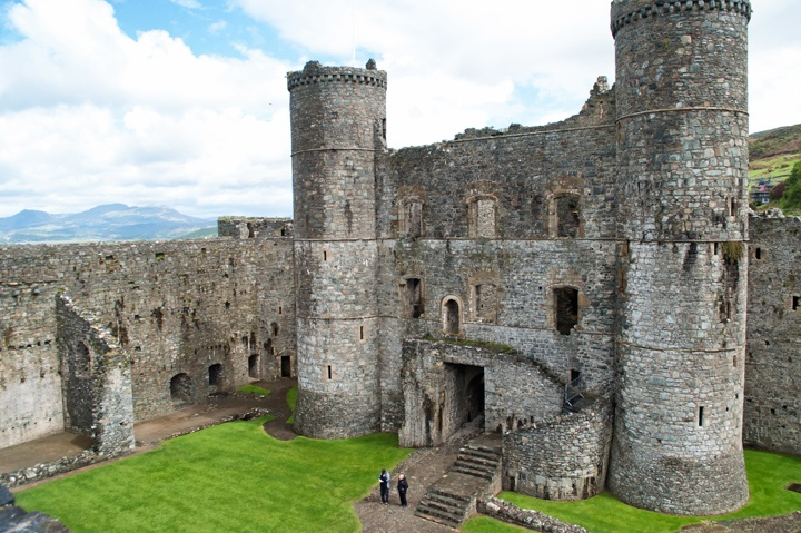Visiting Harlech Castle in North Wales, one of the country's most impressive medieval castles in a spectacular position on a spur of rock overlooking the coast.