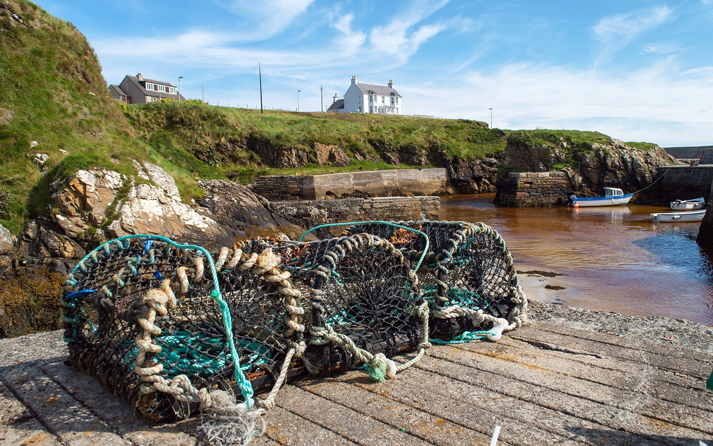 Lobster pots in the harbour at the Port of Ness, Outer Hebrides