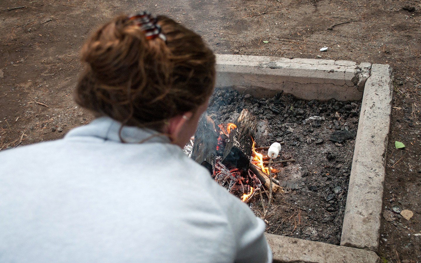 Toasting marshmallows on the campfire on a RV trip across Canada