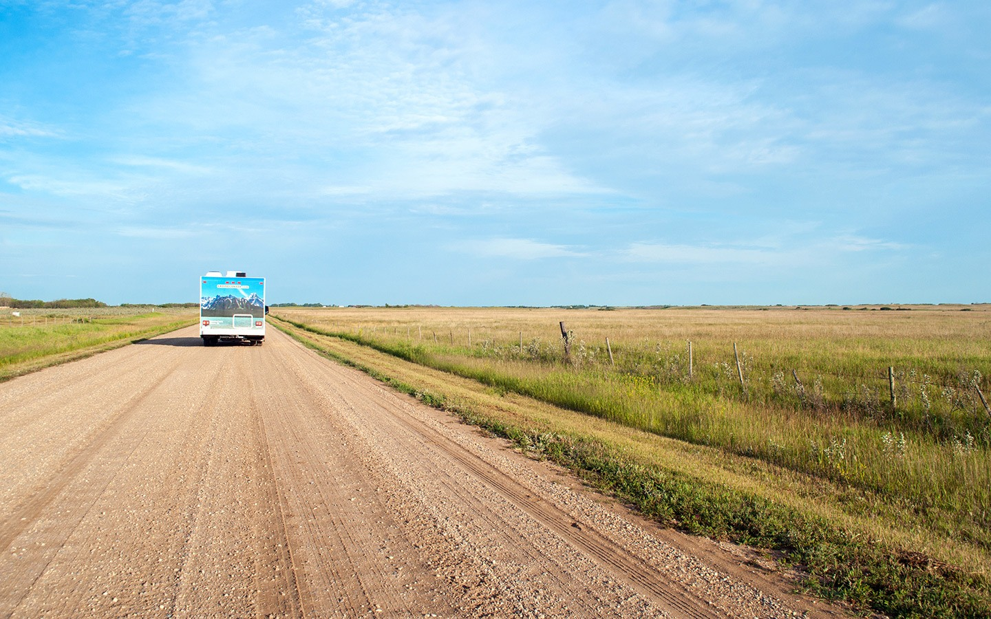 RV on an unsealed road in the Canadian Prairies