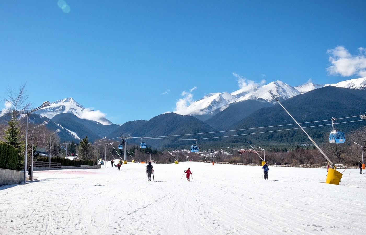 Skiers on the slopes at Bansko ski resort