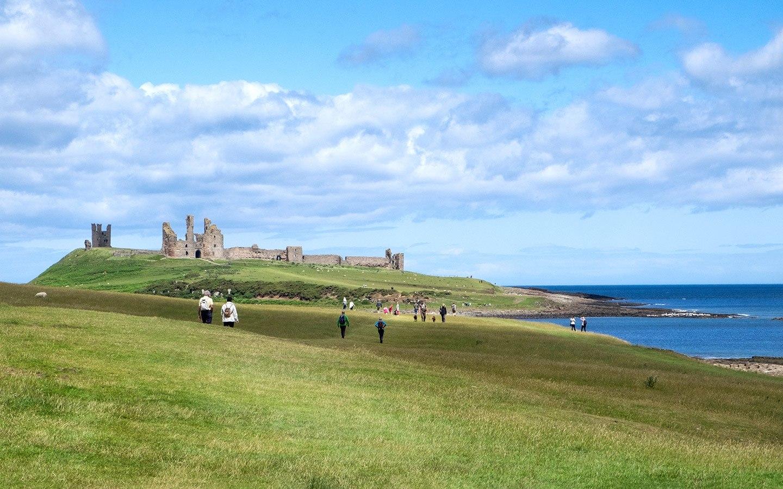 Dunstanburgh Castle on a UK walking holiday along the Northumberland Coast Path