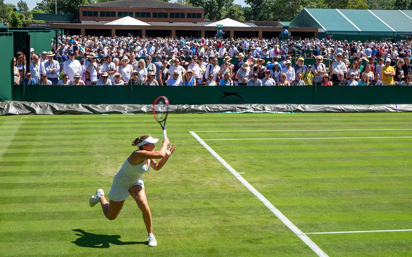 Female tennis players on court