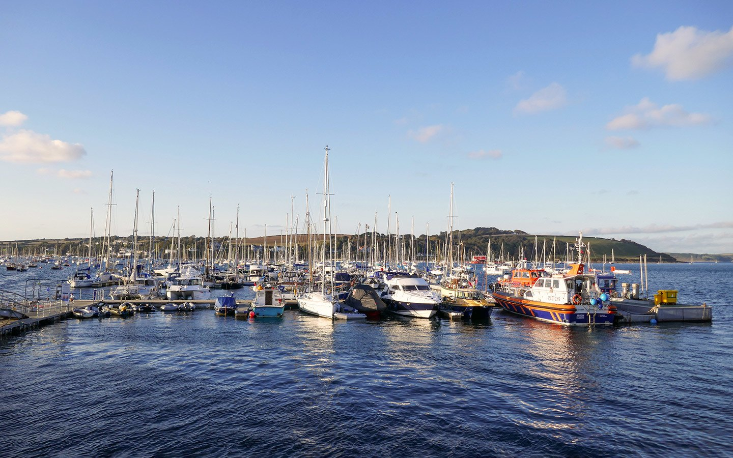 Boats in the harbour at sunset