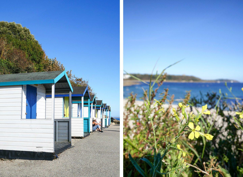 Swanpool Beach huts and coast path in Falmouth, Cornwall