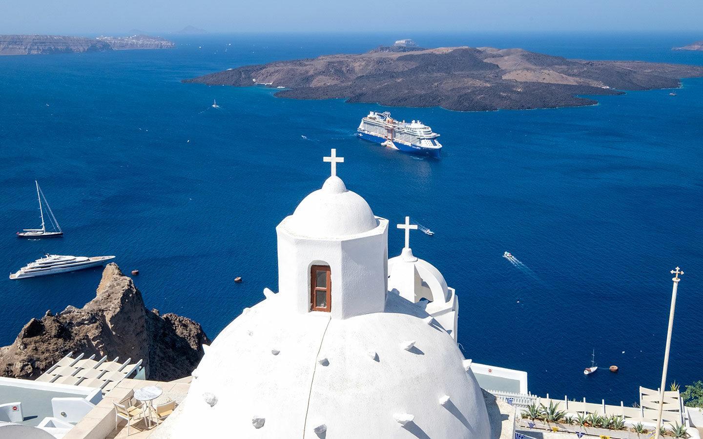 Celebrity Apex cruise ship docked in Santorini